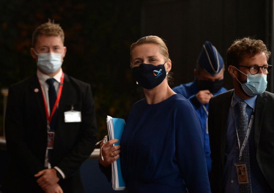 Denmark's Prime Minister Mette Frederiksen wearing a face mask.