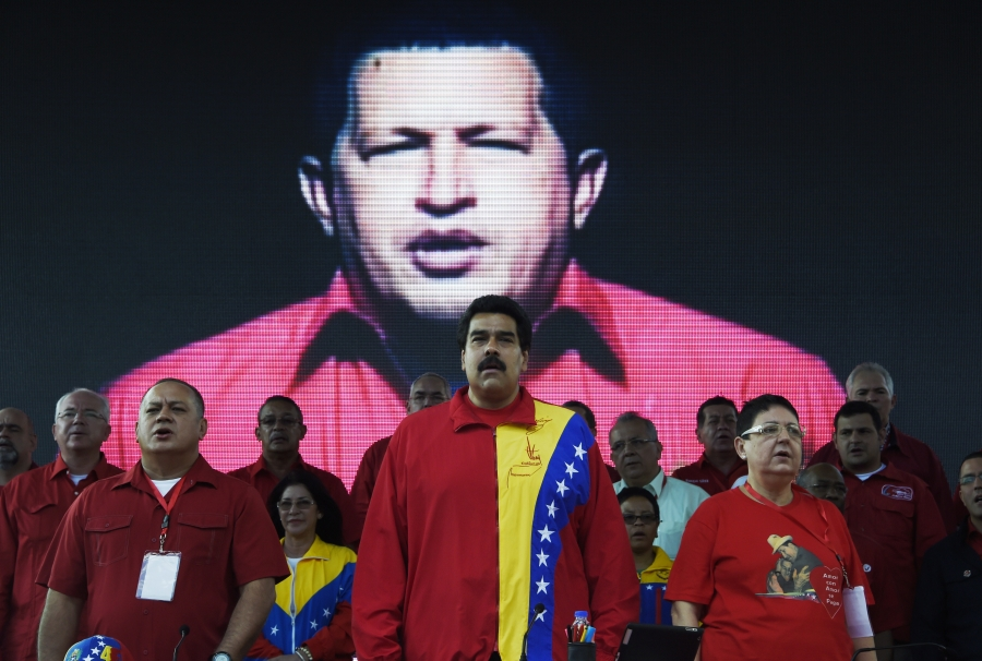 Venezuelan President Nicolas Maduro is seen standing among other guests and authorities.