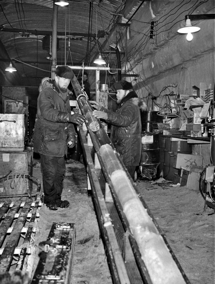 Engineers pull up a section of the 4,560-foot-long ice core at Camp Century in the 1960s.