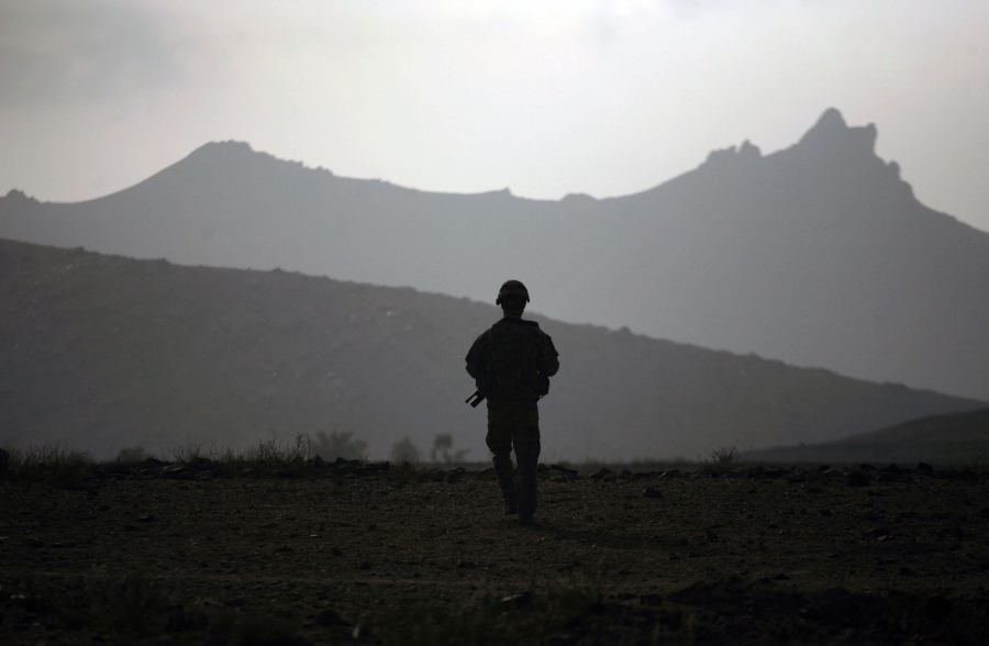 Silhouette of soldier with mountains in the background