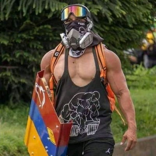 Capitán Colombia has a comic book hero's physique and an activist's social critique.