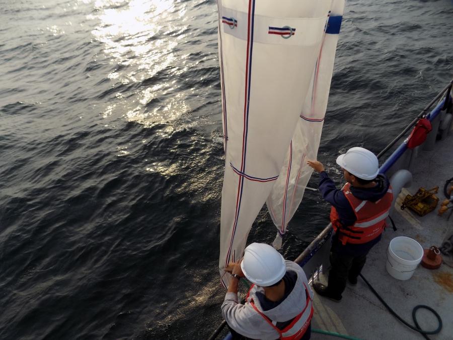 Researchers deploy plankton sampling nets in Lake Michigan.