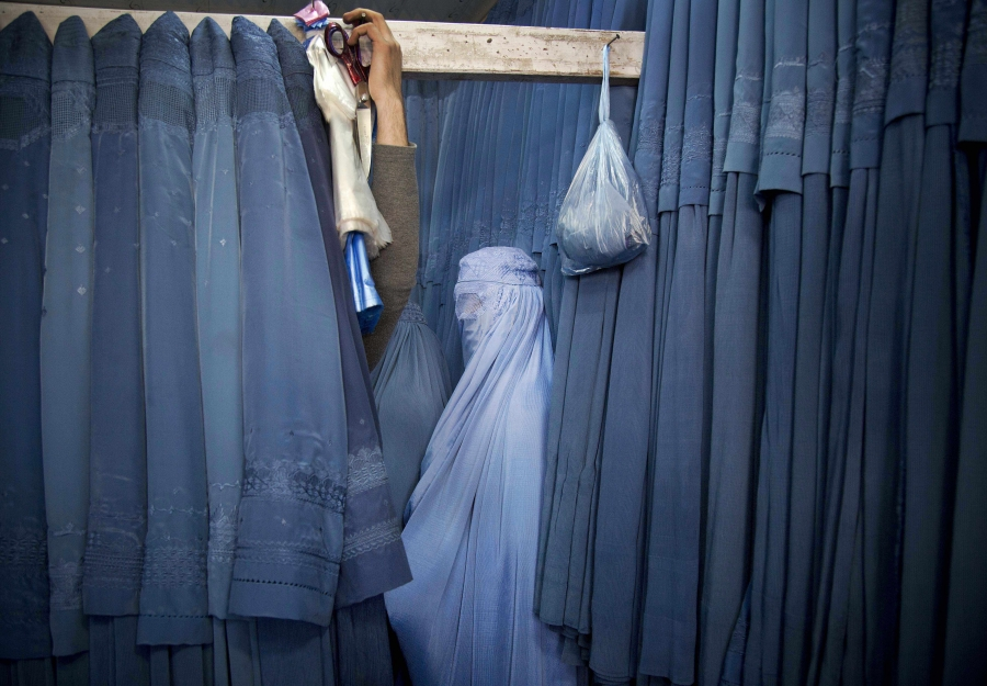 An Afghan woman waits in a changing room to try out a new Burqa, in a shop in the old city of Kabul, Afghanistan, on April 11, 2013. Before the Taliban took power in Afghanistan, the Burqa was infrequently worn in cities. While they were in power, the Tal