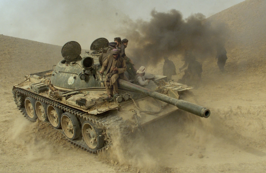 Defecting Taliban fighters maneuver a tank through the front line near the village of Amirabad, between Kunduz and Taloqan, on Nov. 24, 2001.