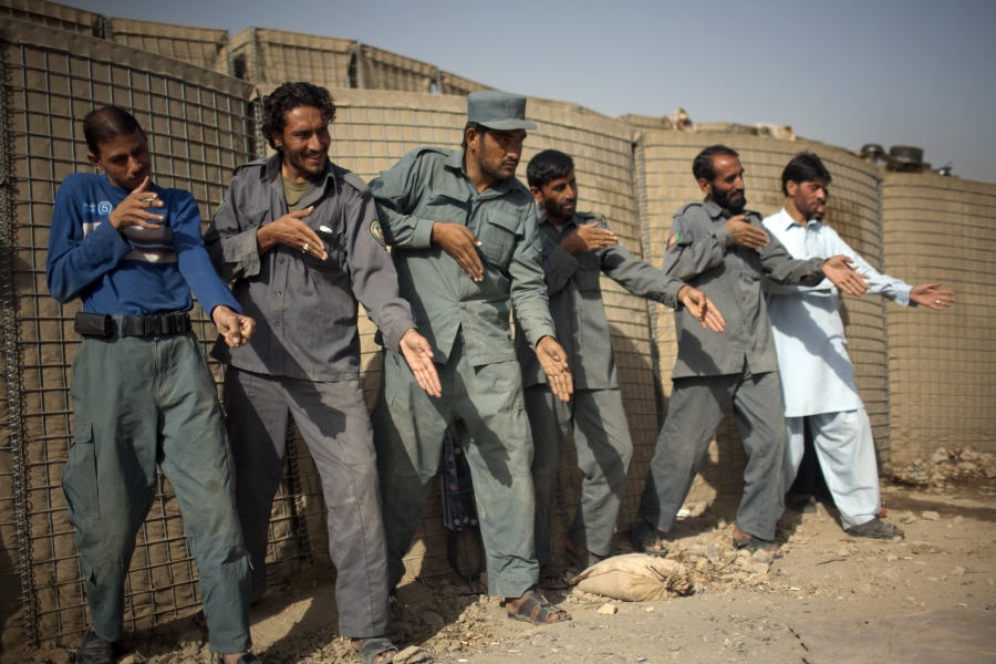 Afghan policemen simulate weapons orientation during a training session with U.S. soldiers from 2nd PLT Diablos 552nd Military Police Company, on the outskirts of Kandahar City, Afghanistan, on Oct. 26, 2010.