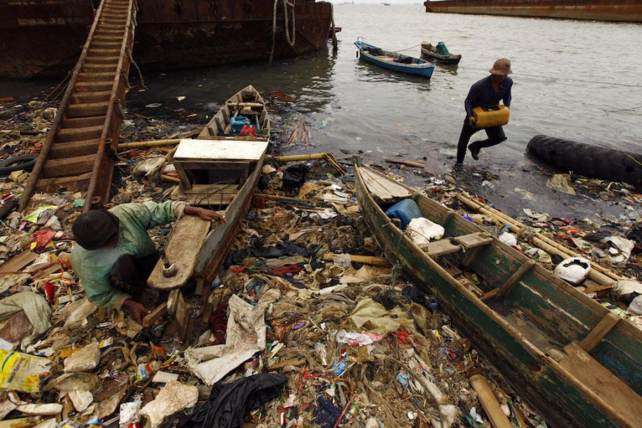Indonesian fishermen on a polluted beach in Cilincing, North Jakarta, June 5, 2013.