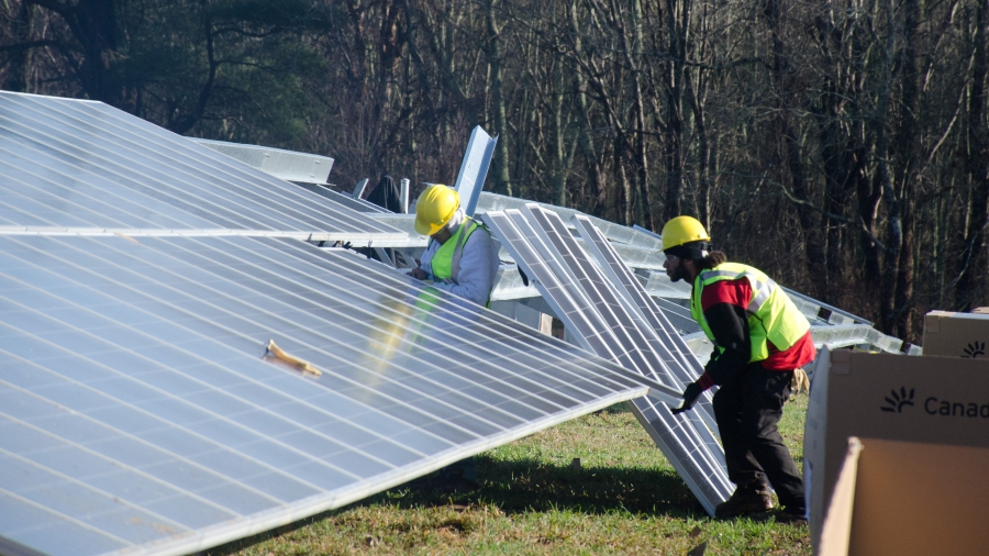 Workers are installing 3,500 solar panels in a field in Fairhaven, a town about 60 miles south of Boston.