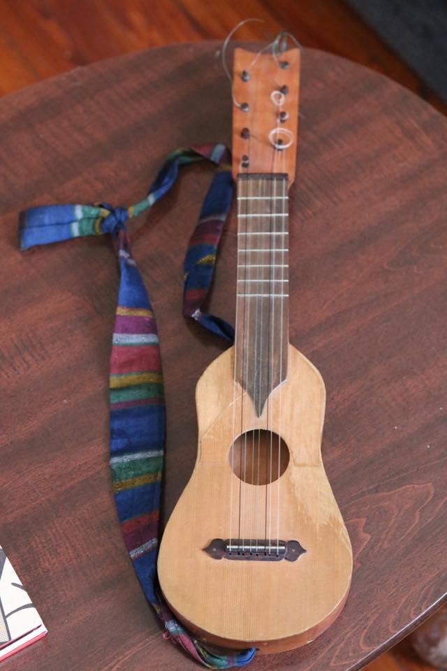 A picture of the jarana musical instrument. It looks like a small guitar.