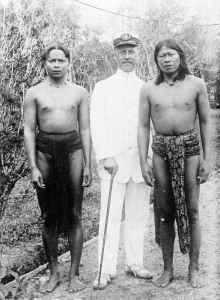 On right, a photo of my great-grandfather, Jan Jongejans, in Indonesia with two local Dayak men.