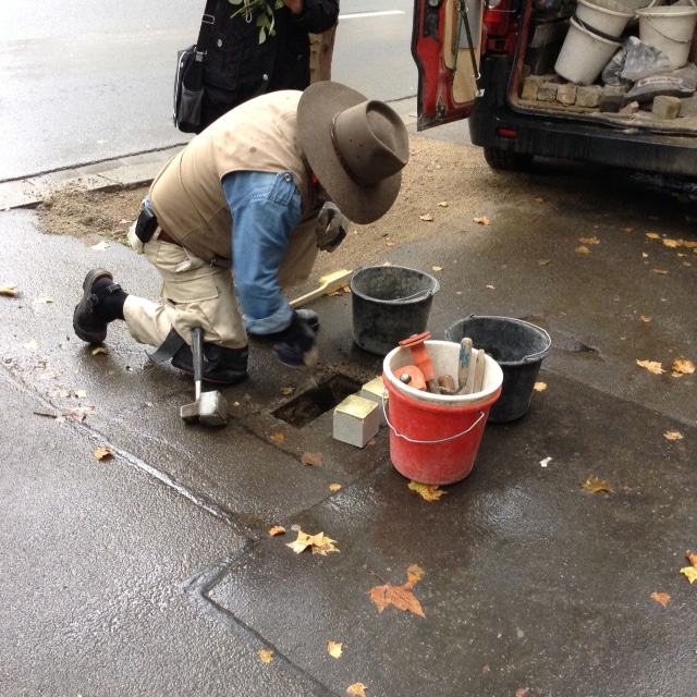 Artist Gunter Demnig at work laying stolpersteins in memory of Juliane and Simon Gaertner in Maintz, Germany October 15, 2015.