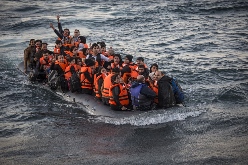 A boat full of approximately 50 refugees arriving in Lesbos.