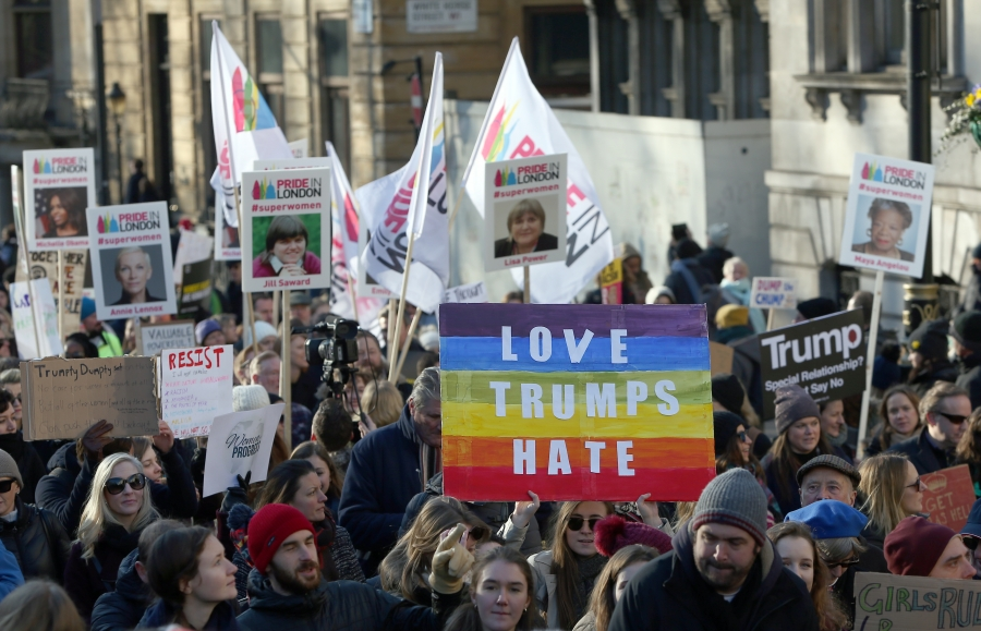 Protesters take part in the Women's March on London, as they walk from the American Embassy to Trafalgar Square, in central London