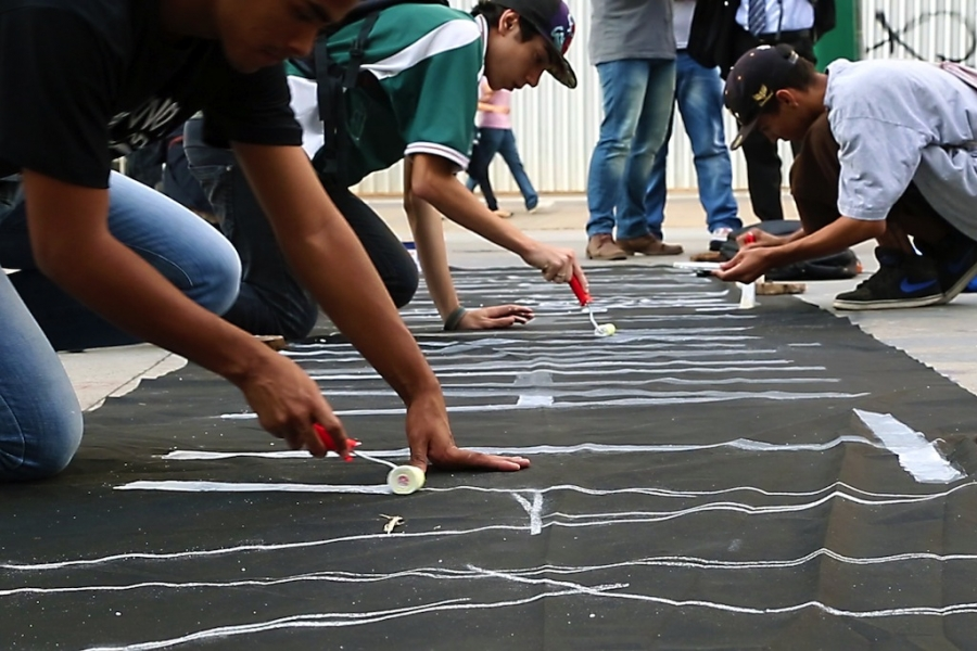 Protesters make signs for Thursday night's demonstration in Brazil.