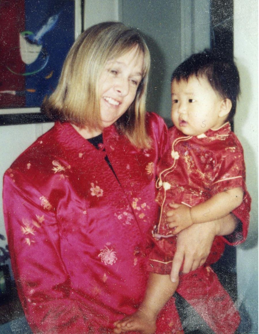Melissa Ludtke, holding her adopted daughter Maya