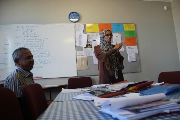 COSAT's principal, Phadiela Cooper, presides at a morning staff meeting. (Photo: Anders Kelto)