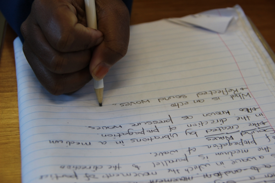 Students take notes in class. (Photo: Anders Kelto)