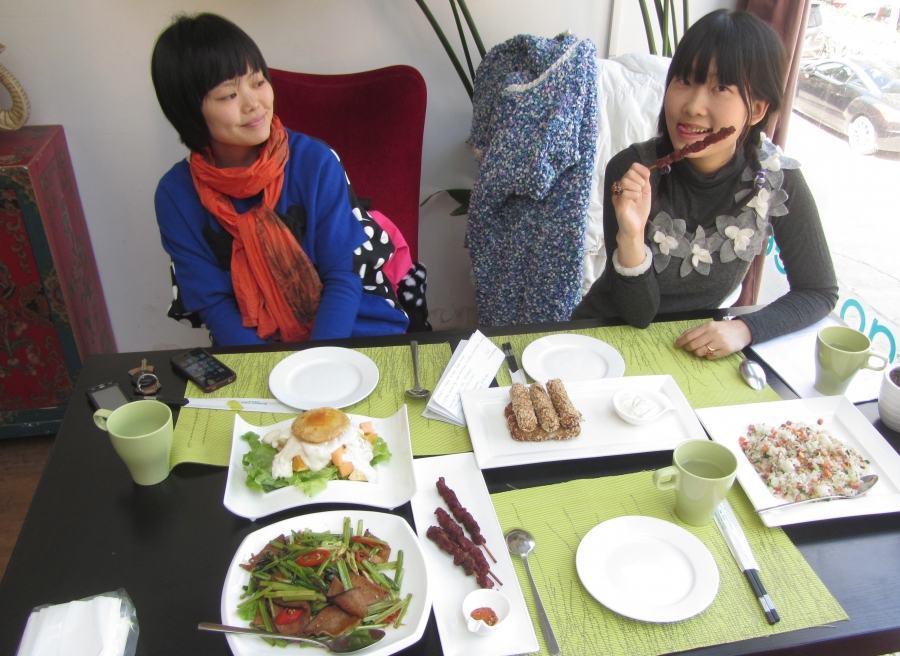 "Vegan activist and singer Long Kuan and a friend enjoy meatless ""lamb"" kabobs at a Beijing restaurant."