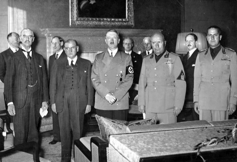 Adolf Hitler (center) and Benito Mussolini (to Hitler's left) at the signing of the Munich Agreement on Sept. 28, 1938.