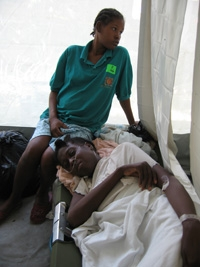 Nathalie LeBrun, in cot with niece Metalienne Anestal. She was a patient at HHS-Gheskio field hospital in Port-au-Prince.