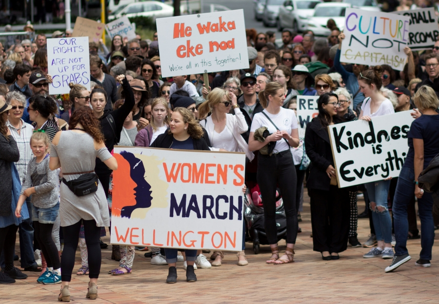 Participants of a rally regarding women's rights hold placards as they march in Wellington, New Zealand, January 21, 2017.