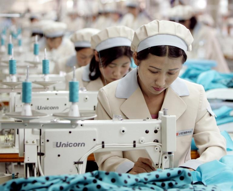North Korea has an established textile industry. Here, North Korean workers stitch clothes for a South Korean brand in Kaesong industrial zone, May 2005.