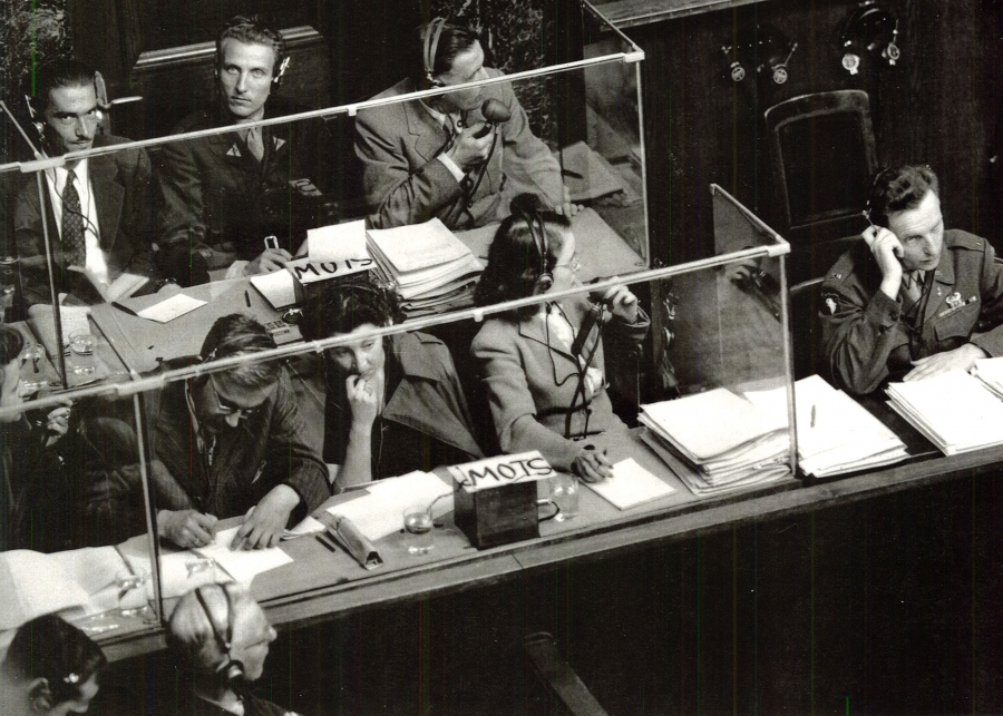 Interpreters at the Nuremberg Trial; Front: English desk; Back: French desk. To the left, monitor.