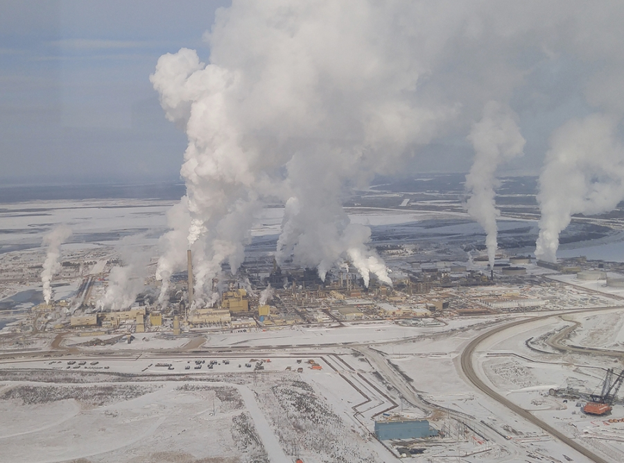 Oil from Alberta's tar sands region is key to the local and national economy, but it's especially carbon-intensive. Production in recent years has also transformed a remote forest wilderness into a barren industrial landscape.