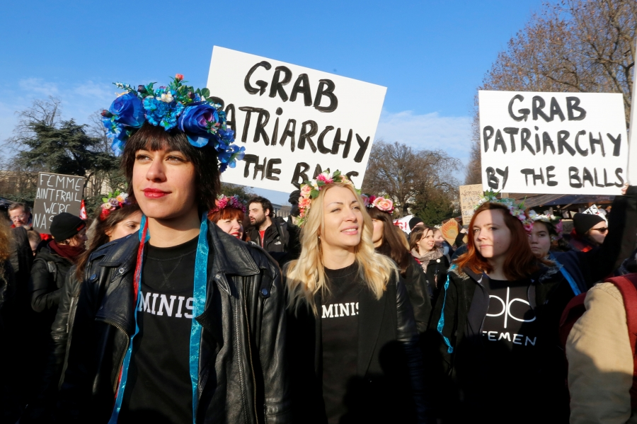 Protesters take part in the Women's March in Paris, France, January 21, 2017