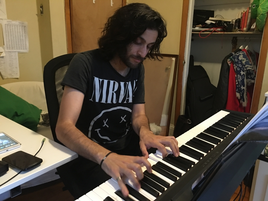 Yazan Al-Hajari fled Syria after composing music that was critical of the Syrian regime.
