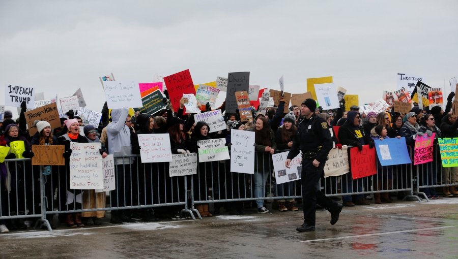 Demonstrators rally against President Donald Trump's refugee and immigration ban during a protest at Detroit Metropolitan Airport in Romulus, Michigan, Jan. 29, 2017.