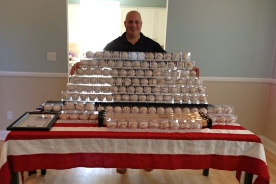 Randy Kaplan with his collection of autographed baseballs