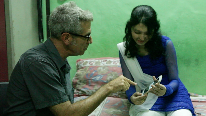 Marco Werman looks at photos from Reshma's latest fashion shoot for her campaign to ban the sale of acid in India.
