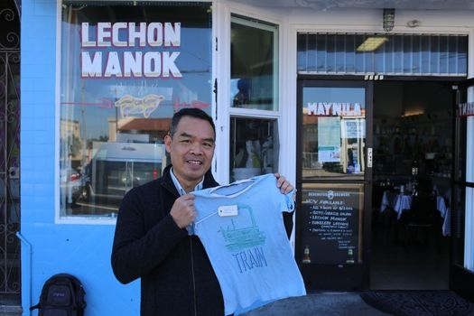 Andrew Lam stands outside the restaurant his aunt and mother onced owned and operated in Daly City, California.