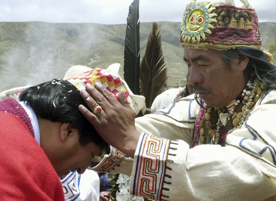 Bolivian President Evo Morales (L) is blessed by Aymara priest Valentin Mejillones during a ceremony at Tiawanaku, a pre-Columbian archaeological site about 40 miles west of La Paz, in 2006. The Aymara people, of which Morales is a member, are the descend