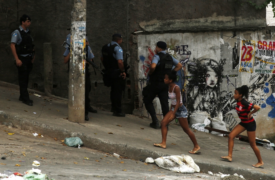 Police officers patrol around the Pavao-Pavaozinho slum in the Copacabana neighbourhood in Rio de Janeiro April 23, 2014.