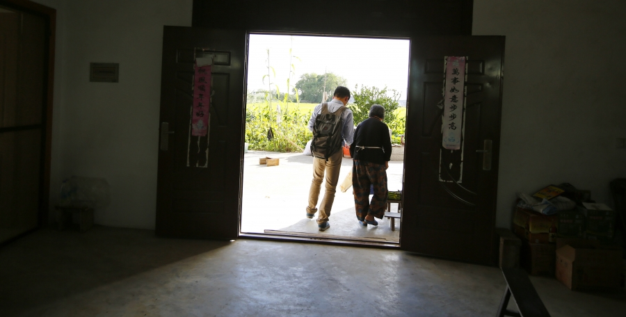 Wang Yufang and her grandson, Gu Hangyu, at her home on Chongming Island, near Shanghai. Gu says when he has a family, he'd like