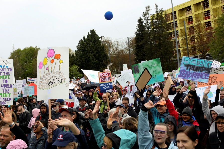 Protestors hold signs during the March For Science in Seattle, Washington, April 22, 2017.