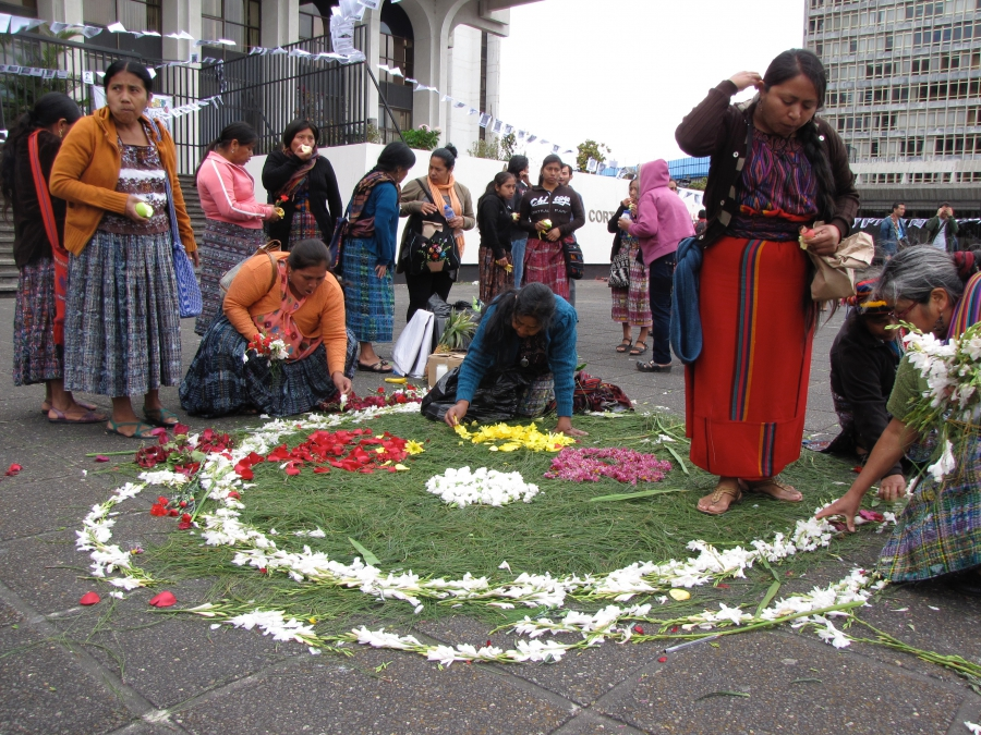 Women lay petals outside the courthouse in Guatemala City on a final day of the Sepur Zarco trial.