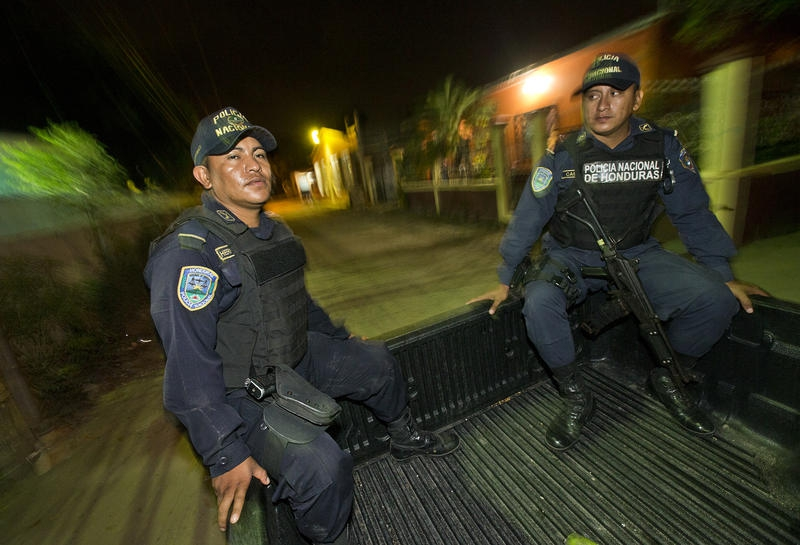 Honduran police officers Edilberto Hernández and Marvin Castro patrol the Chamelecón neighborhood in San Pedro Sula, Honduras.
