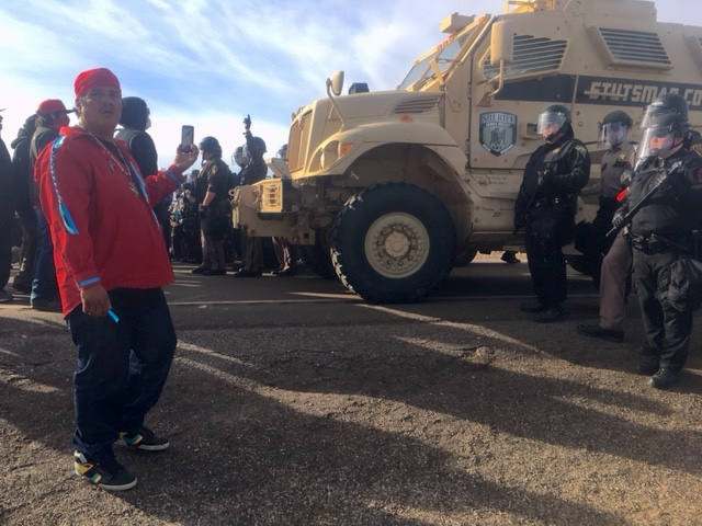 Protesters face off with law enforcement officers on a highway at the contested pipeline construction site near the Standing Rock Reservation and the Missouri River.