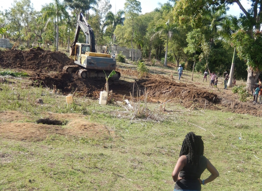 Regine Theodat observing construction for a tilapia farm in Savanne Perdue, a neighborhood of La Hoye, Haiti, October 2013.