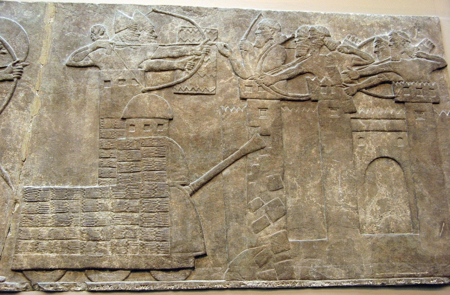 Assyrian attack on a town with archers and a wheeled battering ram; from a relief dated 865–860 BC, taken from the North-West Palace of Nimrud; now in the British Museum.