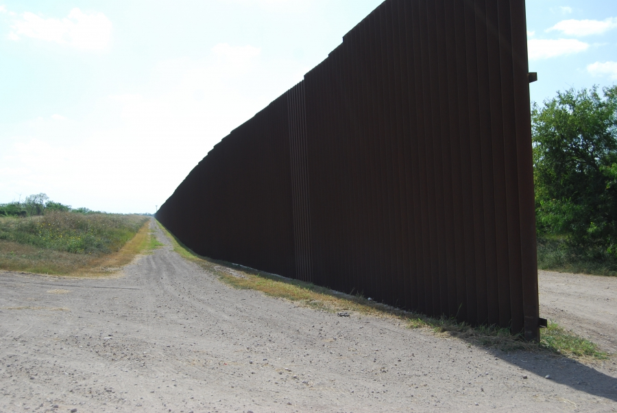 The 18-foot border wall in Hidalgo, Texas, starts and stops, with gaps, along the Rio Grande River.