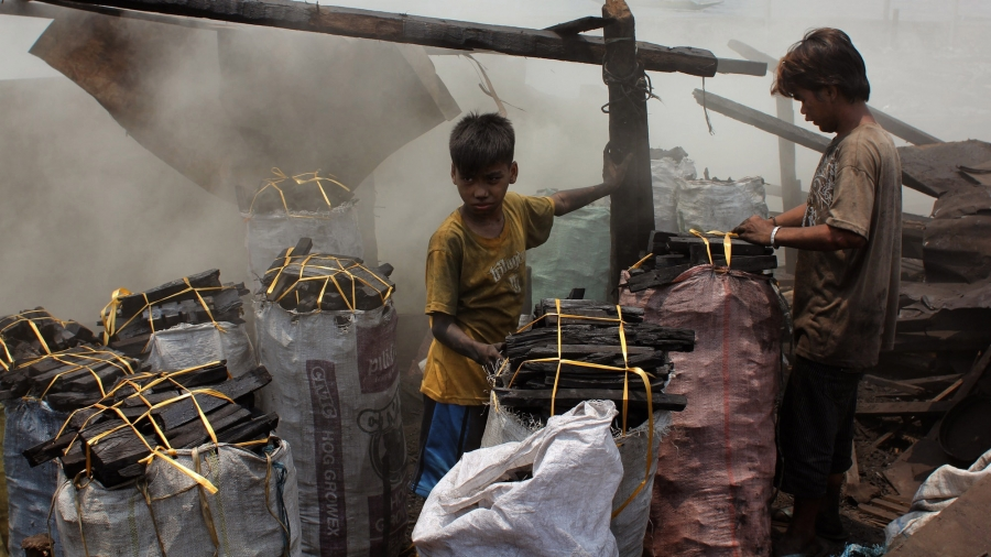 Ana Lisa Loste lives near the part of the slum called ulingan, where crude charcoal kilns burn all day, filling the air with stinging smoke. Children and young men work packing and curing the charcoal.