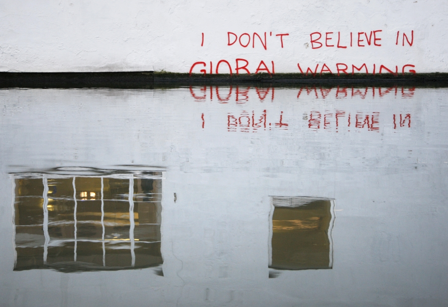Graffiti art on a wall next to the Regent's Canal, London December, 2009. British media have attributed the work to street artist Banksy.