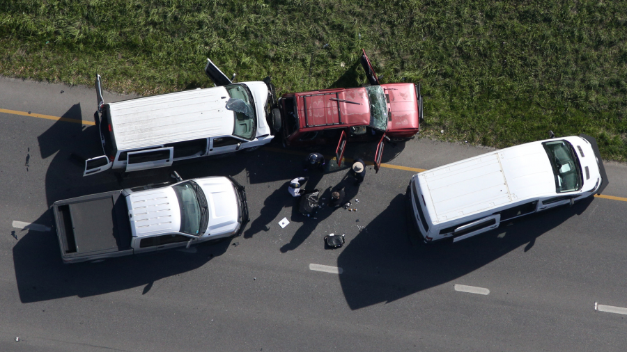 Law enforcement personnel investigate the scene where the Texas bombing suspect blew himself up on the side of a highway north of Austin in Round Rock, Texas, March 21, 2018.