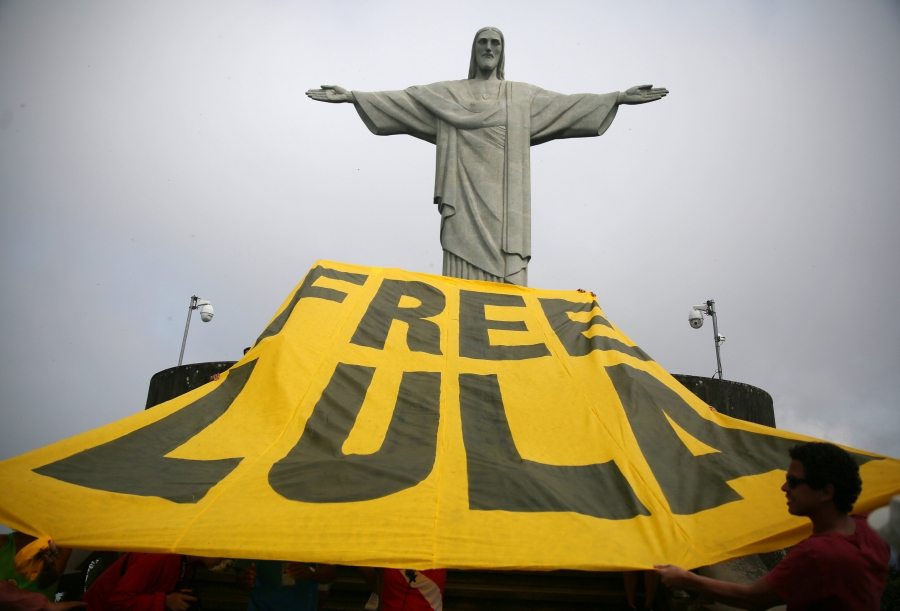 "Supporters of former Brazilian President Luiz Inacio Lula da Silva display a yellow banner reading ""Free Lula"" in front of the statue of Christ the Redeemer in Rio de Janeiro, Brazil, on April 14, 2018."