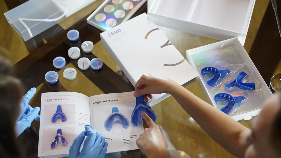 Candid Co. sends customers a kit to take impressions of their teeth from home. An orthodontist then remotely comes up with a treatment plan.