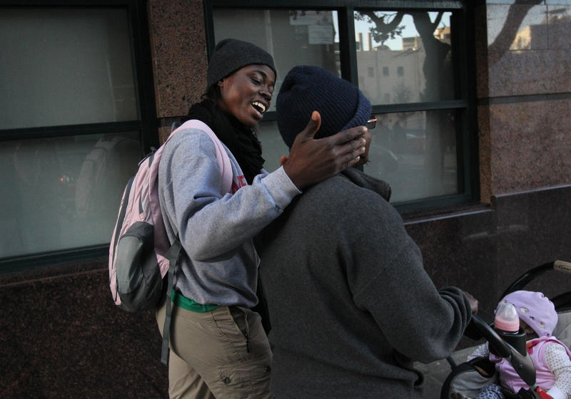 Carine and her girlfriend Gertrude, who were persecuted for being gay in Cameroon, push their daughter down the street in San Francisco's Tenderloin district. The two women have been granted asylum in the US.