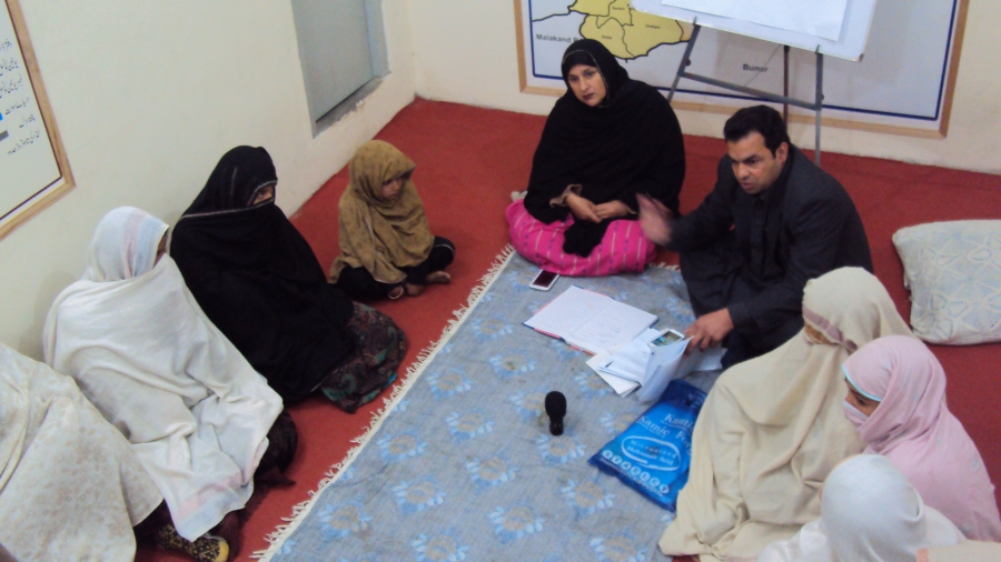 Tabassum Adnan (face pictured) leads a women's jirga in the Swat Valley in northern Pakistan. Along with a male attorney, she is advising the group as women detail crimes against them such as robbery and physical abuse.